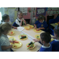 Class 1 creating their own salad