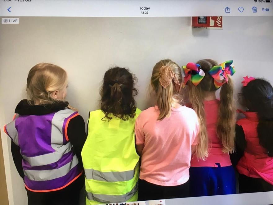 Brightly coloured jackets and hair accessories