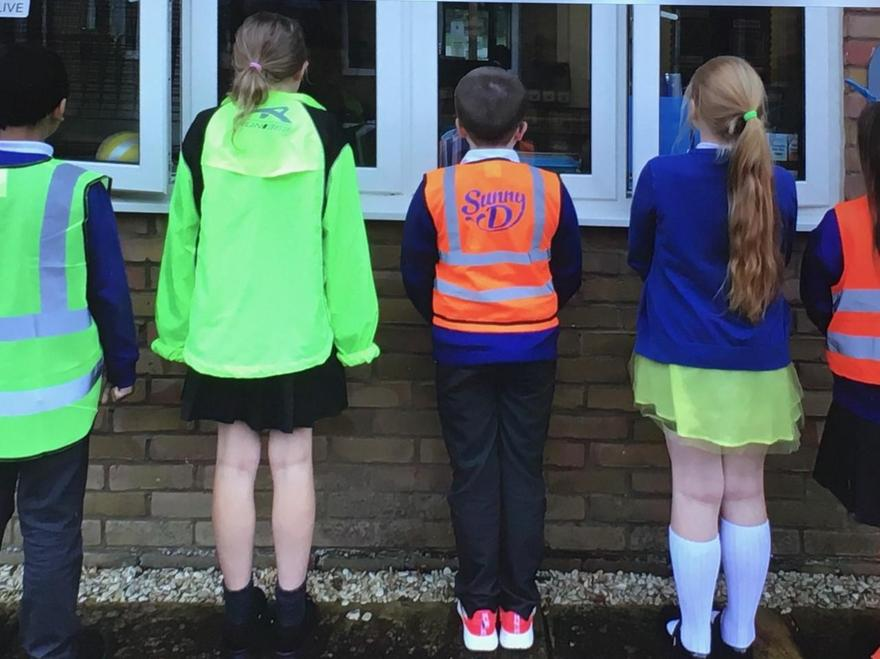 Hi vis jackets, brightly coloured trainers and skirts!