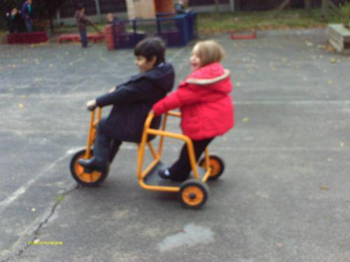 Riding together on the wheeled toys.