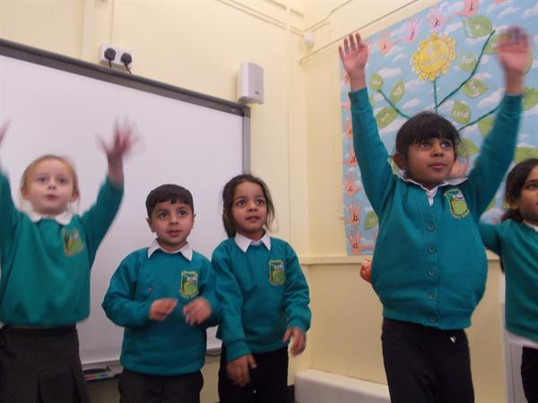 Enjoying singing and performing action songs.