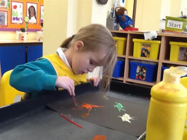 Firework pictures using straws and paint.