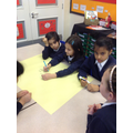 Brainstorming ideas for their group Kennings poems