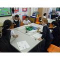 Deciding upon properties of materials.