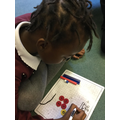 Using concrete equipment to complete maths problems
