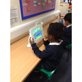 Completing a phonics game on the iPad