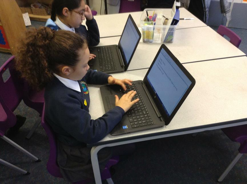 Orally rehearsing a diary entry using the laptops