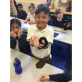 looking at Roman coins and clothes