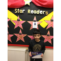 Year 5's Autumn 2 star reader is Isa for his commitment to improving his reading.