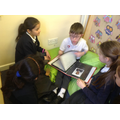 Share a book of poems the class created