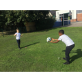 Passing a rugby ball and using the W grip