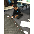 Rounding using a beaded number line.