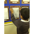 Aleem proudly putting his work on the display