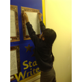 Hafsa proudly putting her work on the display