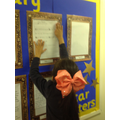 Amilah proudly putting her work on the display