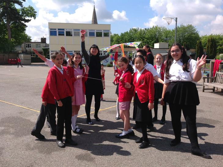 Mrs Li and some children in Y6 flying a kite!
