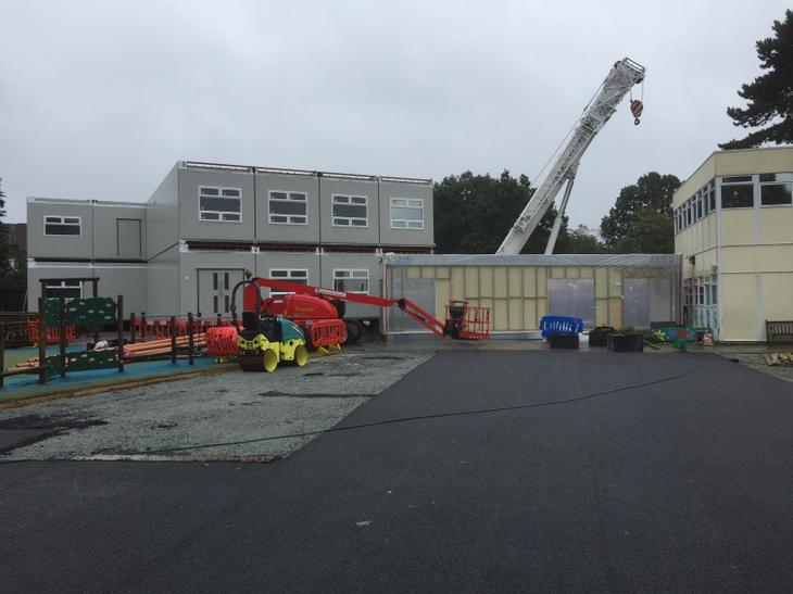 The crane placing the new classroms