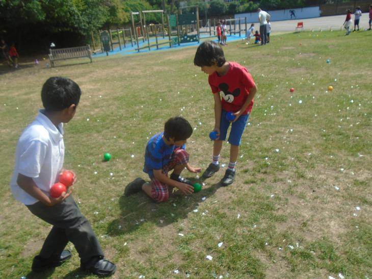 Children enjoying a game of  boules during  French