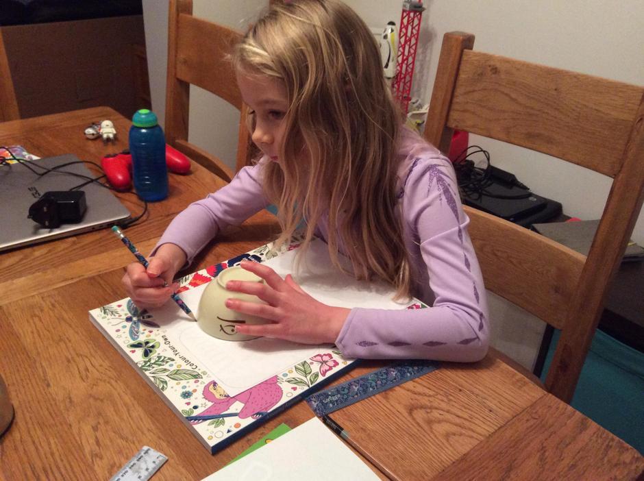 Esme (aka Elsa) drew around a bowl for a circle.