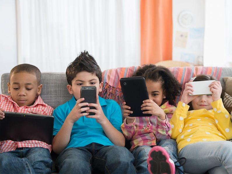 Kids on electronic devices
