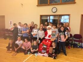 Sycamore Class meeting Santa.