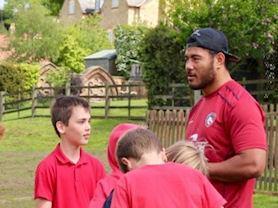 Manu initiating the rugby tournament.