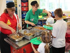 Mrs Burrows and Mrs Fegan serve our lunch every day.