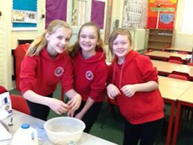 Year 5 girls preparing their pancake mixture.