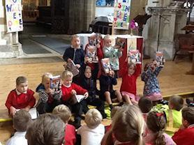 Reception Children receiving their bibles in church.