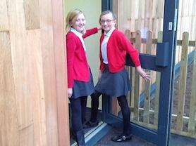 Year 6 girls entering the building.