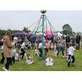 Waltham children dancing the maypole
