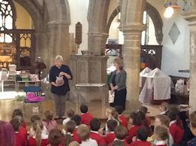 The whole school saying 'thank you' to Reverend Beverley. We will miss you!