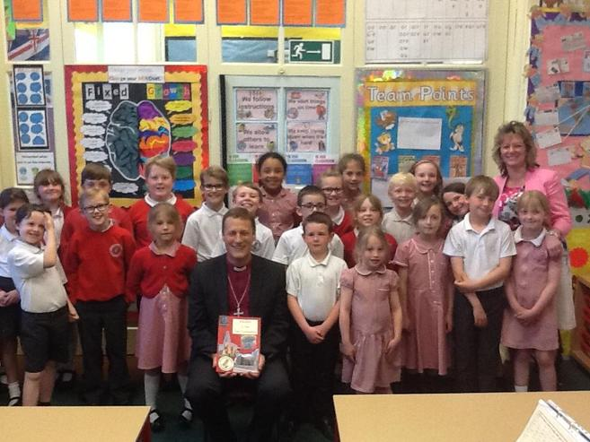 Bishop Martyn receiving the famous Waltham cookbook