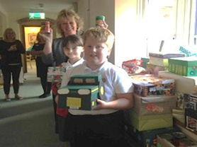 Mrs Hopkins and the Owl Minsters deliver the Harvest Boxes to Dove Cottage.