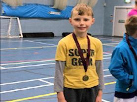 Our superstar runner proud of his medal.