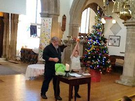 Mr Alexander creating the Christingle.