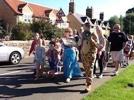 Whole school singing our Charter Fair Chant at Waltham-on-the-Wolds village Charter Fair.