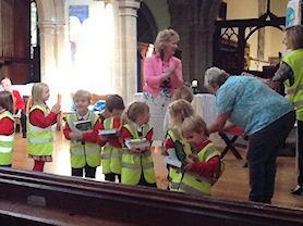 Reception children receiving their new Bibles.