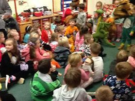 The whole school with their puppets.