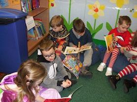 Little ones loving books.