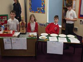 Sycamore children displaying their project work.