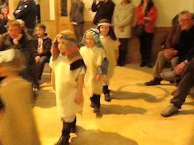 Shepherds following the star to Bethlehem.