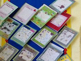 Our covers for our summer homework using shaving foam and food colouring.