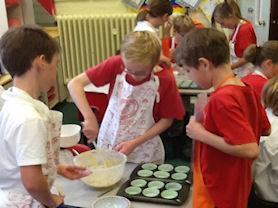Master Chef class-making cakes for Macmillan coffee morning.