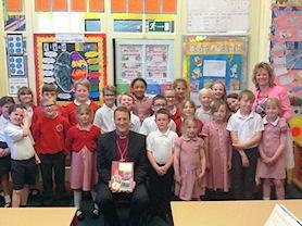 Bishop Martyn with his card and cook book.
