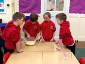 Year 3 children mixing the ingredients.
