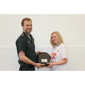 Mrs Bridges receiving the defibrillator.