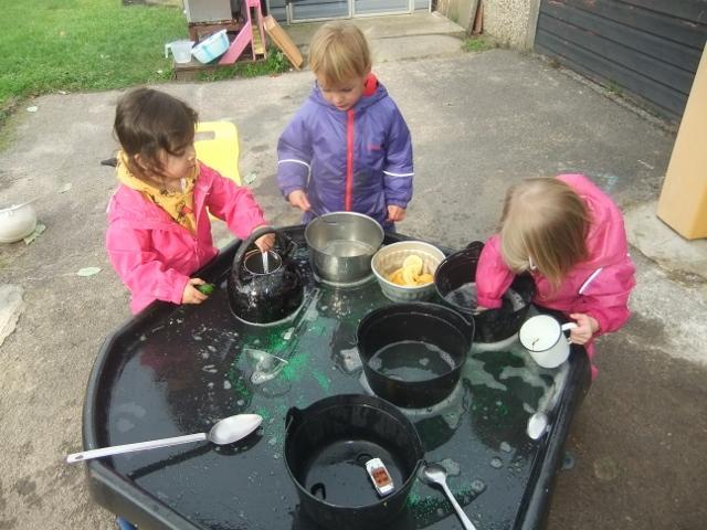 Making witches potions in the garden