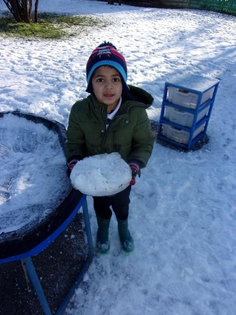 We played with snow in the mud kitchen.