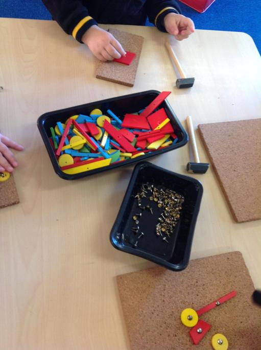 We have to tap the pins using the hammer in to the cork boards.